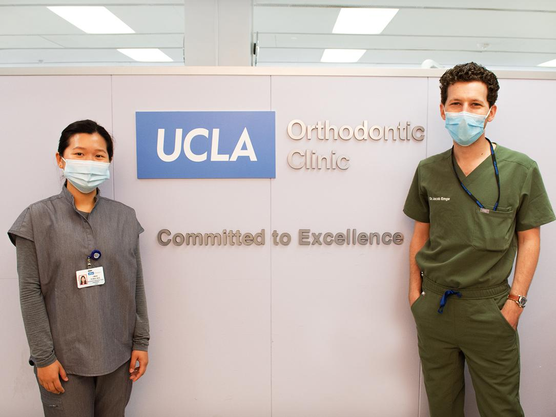Residents in front of the new Orthodontic Clinic sign.
